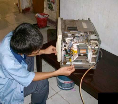 Tự sửa trục lò vi sóng Sharp